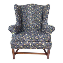 Used Upholstered Wingback Armchair - We love the field animal upholstery on this classic wingback armchair. The blue wool fabric is decorated with pheasants and hunting dogs. The chair features a classic wingback design with fruitwood legs. This is the perfect reading chair for a library or lounge.