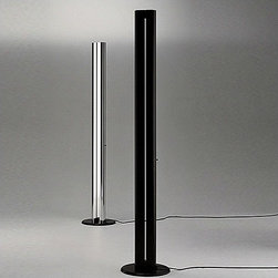 Artemide - Megaron Floor Lamp - The Megaron floor lamp is great for indirect halogen lighting. This floor standing luminaire has a two section body in extruded aluminum with a polished natural aluminum finish or glossy black finish. The Megaron also has a high efficiency reflector in anodized aluminum. FEATURES: -Floor lamp -Megaron Collection -Two-section body in polished black anodized aluminum finish, with incorporated slide dimmer control lever -Concealed high efficiency reflector in anodized aluminum -Base in molded black rubber coated steel -Accommodates (1) 300 watt (R7s/T3) halogen bulb (included)  Installation Instructions