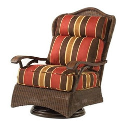 Whitecraft by Woodard Chatham Run Swivel Lounge Chair - Rugged enough for the man cave or the great outdoors, the Whitecraft by Woodard Chatham Run Swivel Lounge Chair offers a bouncy, swiveling ride for thorough relaxation. With tough synthetic wicker on an aluminum frame, this chair is finished with crucial details like cast-resin branch replicas for the feet and arm supports for an authentic lodge experience. Armrests in an appealing mahogany finish are actually faux, made of resin for greater durability and ease of care than wood. That means no cracking, peeling, or chipping, ever; and that goes for the wicker, as well. As a member of Woodard's All Seasons Outdoor Wicker collection, this piece was crafted with pride in South Carolina. Choose from a dizzying selection of fabric types and colors for a chair that's uniquely yours. Upgraded trim is also available on the cushions for an additional charge.WickerOK. Unravelling, mouldering wicker has no place in your retreat. We understand. But the future of wicker is here: high-density Viro wicker weave is impervious to water and humidity and never needs painting or finishing. UV-protection is built in to the material, along with the variegated Choconut color. Since it's water resistant, it's not afraid to get involved in rain dances, super soaker fights, and sprinkler parties. In accordance with Woodard's commitment to environmental responsibility, Viro wicker does not release hazardous compounds into the environment over time, and this chair is 100% recyclable.FrameLightweight, strong aluminum rods are connected (welded, when possible) to create a strong frame for this swivel lounger. A powder coat finish is applied through heat treatment to protect against corrosion. All edges and joints are covered with hand-woven wicker for a polished look.CushionsNote the aforementioned fabric options. Stuffing for the backrest pillows consists of blown polyester fiber encased in waterproof polyethylene. The seat cushions bear weight, so they require sterner stuff; they're formed of thermally bonded polyester fiber. Seat cushions are constructed to shed and drain water when they do get saturated. Fill materials are flame-resistant in compliance with California Spec. 117. Cushions can be turned over for extra long wear.Woodard: Hand-crafted to Withstand the Test of TimeFor over 140 years, Woodard craftsmen have designed and manufactured products loyal to the timeless art of quality furniture construction. Using the age-old art of hand-forming and the latest in high-tech manufacturing, Woodard remains committed to creating products that will provide years of enjoyment.Most Woodard furniture is assembled by experienced professionals before being shipped. That means you can enjoy your furniture immediately and with confidence.Together, these elements set Woodard furniture apart from all others. When you purchase Woodard, you purchase a history of quality and excellence, and furniture that will last well into the future.Important NoticeThis item is custom-made to order, which means production begins immediately upon receipt of each order. Because of this, cancellations must be made via telephone to 1-800-351-5699 within 24 hours of order placement. Emails are not currently acceptable forms of cancellation. Thank you for your consideration in this matter.