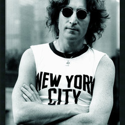 Amanti Art - John Lennon - NYC Framed with Gel Coated Finish - Love Lennon? Decorate with an iconic John Lennon music poster. In this black & white photography portrait, the famed Beatles frontman strikes a casual pose in a classic New York City t-shirt.