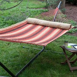 Island Bay Dura-Weave Quilted Hammock with Steel Stand - Additional features: Stand dimensions: 13 - 15 ft. L x 4 ft. W x 3 ft. 9 in. H Dura-Weave fabric is water- mildew- and UV-resistant for lasting use 100% FSC-certified wood spreader bars UV-resistant polyester rope Hanging distance min/max: 13 ft./16 ft. Zinc-plated hanging hardware included Hammock comes with an FSC-certified hang tag Perfect for cuddling up with a good book or enjoying an afternoon siesta, the Island Bay Dura-Weave Quilted Hammock with Steel Stand is as fetching as it is functional. Made of soft, yet extremely durable water- mildew- and UV-resistant Dura-Weave fabric that will offer years of enjoyment, this hammock also scores high in the comfort factor. You'll be enveloped in such luxury, thanks to the soft fabric and the coordinating bolster pillow, that you might find yourself spending more time outdoors than you've ever done before! Choose from several striped patterns to brighten up your outdoor setting. Responsibly harvested Forestry Stewardship Council (FSC)-certified spreader bars hold the hammock open for easy getting in and out. It has a weight capacity of 450 pounds and the dimensions of the bed itself are 6 feet 8 inches in length and 4 feet 6 inches in width. Powder-coated for weather- and rust-resistance, the heavy-duty steel stand is built to last and comes in a choice of finishes to enhance the beauty of your hammock. One of our most beloved hammocks, the Island Bay Dura-Weave Quilted Hammock has constantly topped our customer favorite list. Taking a cue from that, we've paired this hammock with one of our sturdiest, most trusted hammock stands, so you can enjoy your new hammock immediately and start making the most of summer! If you want to make your summers memorable, you won't go wrong with this hammock set. About Dura-Weave Equivalent to well-known Sunbrella fabrics in durability and weather-resistance, Dura-Weave textiles consist of 100% solution-dyed polyester with an impressively long, colorfast life. Designed for those who want the softness and comfort of cotton with the strength of polyester, Dura-Weave rope and quilted hammocks offer exceptional quality at a much more economical price than similar quality hammocks. Rigorous testing has proven Dura-Weave's ability to withstand fading, tearing, rubbing, weathering, and even melting. You can count on Dura-Weave to be extremely UV-resistant - this textile has 1000 hours of colorfastness. Dura-Weave quilted and rope hammocks are mildew-resistant, and water repellent. They won't snag, tear, or wear out easily, and they're age-resistant. Dura-Weave is a textile you can count on to look good and stay strong season after season. About Island Bay HammocksIsland Bay Hammocks come to you directly from skilled hammock artisans, and feature the Island Bay logo on the spreader bar. Using the latest technology alongside time-tested traditional methods of construction, these hammocks are woven with the pride of their makers.