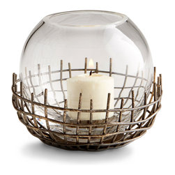 Silk Candleholder - Small - A delicate bubble of glass rests in a heavily distressed, grid-form metal cup, contrasting the smoothness and weightlessness against rougher texture for an eloquent appearance. The Small Silk Candleholder is perfect for mantels and centerpieces in transitional homes, especially when you prefer a slightly urban look of aged and architectural drama.