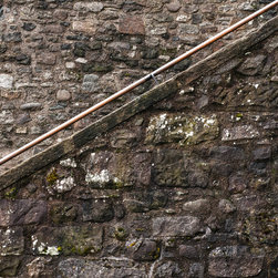 "Stair Rail, 16x16"" fine art color photograph - A strongly minimalist, graphic photo of a wooden rail against a stone wall. Available as a 16x16"" limited edition fine art photograph, printed archivally on photo rag paper. Unframed."