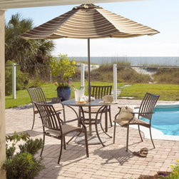 Hospitality Rattan - Panama Jack Island Breeze 5 Piece Slatted Patio Dining Set - Espresso Dark Brown - Shop for Tables and Chairs Sets from Hayneedle.com! A blend of classic design elements contemporary aesthetics and practical function the Panama Jack Island Breeze 5 Piece Slatted Patio Dining Set - Espresso is just what you need to enjoy countless alfresco dinners with family and friends. Showcasing graceful lines and subtle curves for a look that works well in all outdoor settings this dining set which includes four arm chairs and a 42-inch round dining table makes a perfect addition to any patio or poolside.Boasting a tubular extruded aluminum frame in a unique powder coated espresso finish that will not rust the arm chairs feature an exclusive woven Twitchell sling fabric which is so comfy that it eliminates the need for cushions seating you and your guests in luxurious comfort throughout your meal. The dining table features an attractive no-glass slatted aluminum top that prevents water accumulation while offering plenty of space for four table settings. With the set being weather- and UV-resistant you are assured of years of enjoyment while the stackable design of the arm chairs makes off-season storage a breeze.Dimensions:Arm chair (each): 25W x 25D x 35H inchesDining table: 42W x 42D x 29H inchesAbout Hospitality RattanHospitality Rattan has been a leading manufacturer and distributor of contract quality rattan wicker and bamboo furnishings since 2000. The company's product lines have become dominant in the Casual Rattan Wicker and Outdoor Markets because of their quality construction variety and attractive design. Designed for buyers who appreciate upscale furniture with a tropical feel Hospitality Rattan offers a range of indoor and outdoor collections featuring all-aluminum frames woven with Viro or Rehau synthetic wicker fiber that will not fade or crack when subjected to the elements. Hospitality Rattan furniture is manufactured to hospitality specifi