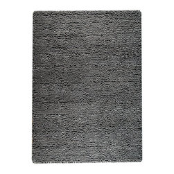 Berber Dark Grey Rug - Deeply shaded in a solid graphite tone, the Berber Dark Grey Rug enhances a space's plush impression while keeping a versatile neutrality that allows it to become a balance point of d�cor in an urban transitional townhouse or an updated traditional home.  Ideal for adding definition to rambling or open floor plans, the rug is made from pure wool for a lush look and feel.