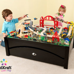KidKraft - Metropolis Train Set on Table with Trundle - Features: -Train table with espresso finish and solid wood frame. -Lets kids take control of an entire city. -Train set is loaded with fun features. -Interactive pieces while the high-quality wooden table take playtime off the floor and closer to eye level. -Large rolling trundle for convenient storage. -100-piece train set. -Two-tier bridge.