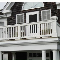 Jamestown Porch Railing - This dignified porch railing is defined by a continuous top rail and square recessed paneled newel corner posts with custom square style caps.