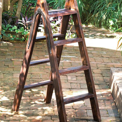 Wood Ladder with Iron Hinge - Handsome hardware and a reclaimed finish to the Wood Ladder with Iron Hinge make this found-object structural piece visually and texturally appealing.  Ideal as a rack for indoor plants or as a large element to bring complexity to the precision of a corner, this ladder also makes a superb display rack for linens.  The uses for this piece are as endless as the intrigue of its natural finishes.