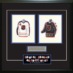 """Heritage Sports Art - Original art of the NHL 1992-93 NHL All-Star jersey - This beautifully framed piece features two pieces of original, one-of-a-kind artwork. Both images are glass-framed in an attractive two inch wide black resin frame with a double mat. The outer dimensions of the framed piece are approximately 28"""" wide x 24.5"""" high, although the exact size will vary according to the size of the original art. At the core of the framed piece is the actual piece of original artwork as painted by the artist on textured 100% rag, water-marked watercolor paper. In many cases the original artwork has handwritten notes in pencil from the artist. Simply put, this is beautiful, one-of-a-kind artwork. The outer mat is a rich textured black acid-free mat with a decorative inset white v-groove, while the inner mat is a complimentary colored acid-free mat reflecting one of the team's primary colors. The image of this framed piece shows the mat color that we use (Medium Blue). Beneath the artwork is a silver plate with black text describing the original artwork. The text for this piece will read: These are original, one-of-a-kind watercolor paintings of both of the 1992-93 NHL All-Star jerseys. These jersey images have been, and continue to be, used to celebrate the history of the NHL All-Star game in posters like the one shown below as well as game programs, magazines and websites across North America. Beneath the silver plate is a 3"""" x 9"""" reproduction of a well known, best-selling print that celebrates the history of the team. The print beautifully illustrates the chronological evolution of the team's uniform and shows you how the original art was used in the creation of this print. If you look closely, you will see that the print features the actual artwork being offered for sale. The piece is framed with an extremely high quality framing glass. We have used this glass style for many years with excellent results. We package every piece very carefully in a double layer of """