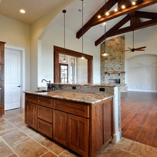 Traditional Kitchen by Capstone Custom Homes