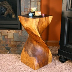 Strata Furniture Single Twist End Table - Hand-carved from a solid piece of monkey pod wood, the Strata Furniture Single Twist End Table features a dramatic twist shape that will look gorgeous with any decor. Finished with a Livos black walnut oil that brings out the natural beauty of the wood, this piece works equally well as an end table, stool, or display stand. It's an eye-catching way to enhance your living room.About Strata Furniture:Determined to deliver furniture with both form and function in its design, Strata Furniture specializes in futons that deliver more than the limited, low-end futon styles. With the look of conventional furniture and the versatility of a futon, Strata's product line features a front-loading wall hugger mechanism that allows you to convert the frame from sofa to bed without lugging a heavy frame away from the wall. Strata's products are built to rigid standards, with quality control standards in place to ensure their furniture is built to last, giving you value and convenience as well as style.