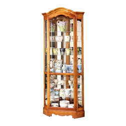 Howard Miller - Jamestown II Crystal-Cut Glass Curio Cabinet - Display fine china, crystals, sterling silverware and other figurines in your exquisitely constructed and expertly designed Oak Yorkshire Curio w Curved Pediment & Halogen Lighting, a stunning piece jeweled with crystal-cut grooved glass among other dynamic craft work. * Crystal-cut grooved glass on the door follows the curves of the pedimentCorner unitFinished in Oak Yorkshire on select hardwoods and veneersHalogen lighting for brighter, whiter, longer-lasting light to illuminate your collectiblesAdjustable levelers under each corner provide stability on uneven and carpeted floorsCabinet is illuminated by an interior lightLocking door for added securityEight levels of display space accommodate your many treasuresGlass shelves can be adjusted to any level within your cabinetNo-ReachT light switch is conveniently located on the back of the cabinetPad-LockT cushioned metal shelf clips increase stability and safety. Fits perfectly in the corner of the room for you to display all your treasures82-1/4 in. H x 34 in. W x 24 in. D