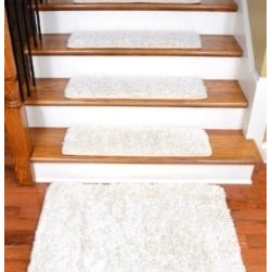 """Dean Flooring Company - Dean DIY Premium Carpet Stair Treads 30"""" x 9"""" & Mat - Deluxe Ivory Shag - Dean Serged DIY Premium Carpet Stair Treads 30"""" x 9"""" - Deluxe Ivory Shag - Set of 13 Plus a 2' x 3' Landing Mat : Quality, Stylish Carpet Stair Tread Rugs by Dean Flooring Company Extend the life of your high traffic hardwood stairs. Reduce slips/increase traction (your treads must be attached securely to your stairs). Cut down on track-in dirt. Great for pets and pet owners. Helps your dog easily navigate your slippery staircase. 100% Luxurious polypropylene shag carpet. Set includes 13 carpet stair treads plus a matching 2' x 3' mat for your landing. Each tread is serged around the edges with beautiful color matching yarn. Rounded corners. No bulky fastening strips. You may remove your treads for cleaning and re-attach them when you are done. Add a touch of warmth and style and a fresh new look to your stairs today with new carpet stair treads from Dean Flooring Company! This product is designed, manufactured, and sold exclusively by Dean Flooring Company. Installation products are sold separately (we recommend our exclusive double-sided mesh tape)."""
