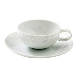 Vista Alegre - Ornament Rings Porcelain Tea Cup and Saucer - Inspired by the ceiling decorations of the Vista Alegre Palace in Portugal, the Ornament collection features an elegant white on white design. The pattern seems as if it's lifting out of the base because of the very delicate grey touch that highlights the shadow. This elegant collection will transform any formal meal into a spectacular royal gala.