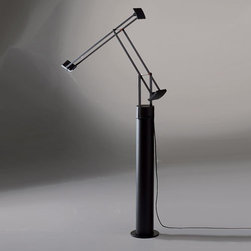 Artemide - Tizio Classic LED Table Lamp with Floor Support | Artemide - Design by Richard Sapper, 2009.The Tizio Classic LED Table Lamp is adjustable to provide direct, task LED lighting. Composed of a fully adjustable, balanced, electrical conductor arms with counter weights and a translucent polycarbonate shield. Features an adjustable die-cast aluminum head whit an inner high efficiency reflector. The bases is 360° rotatable with an incorporated low voltage transformer and dimmer. The Tizio Classic LED Table Lamp with Floor Support features a floor support composed of lacquered steel that converts the Tizio Classic LED to a floor lamp. LED is tested in accordance with IES LM-79-08.  UL Listed.