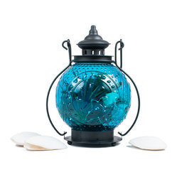 The Firefly Garden - Octopus's Garden - Octopus's Garden opens a secret portal to the magic of the deep sea. These beautiful orbs are filled with treasures of starfish, seashells, grass, moss, and precious succulents. Choose from three colors of oceanic glass to accent any setting in your home.