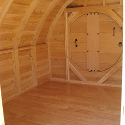 Hobbit Hole Cottage - Interior floor dimensions are 12' x 10'.  Ceiling heigh ranges from 3' on the sides to over 7' in the center. All cedar interior. Hardwood floor.
