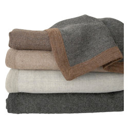 Area Inc. - Liam Graphite King Blanket - Area Inc. - Give your king size bed a simple, chic update using the Liam Graphite Blanket. Featuring knitted edges and a solid all natural graphite color, this blanket blends well with both bright and subdued color schemes. Made from 100% baby alpaca fiber, the blanket is irresistibly soft and cozy, but still light enough to use in warm weather seasons. Dry clean only. The graphite blanket is pictured at the bottom.