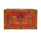 Golden Lotus - Orange Double Elephant Iron Hardware Tibetan Trunk - This Tibetan trunk is in orange base color and decorated with shadow motif around the edge. The center theme is a pair of elephants carrying treasure beads. It is an unique decorative storage box or as a side cocktail table.