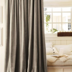 Velvet Drape - Like blankets for your walls, velvet curtains keep the warmth in your house while softening the look of your windows.