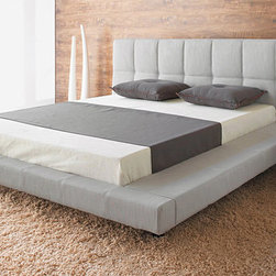 Suite Queen Bed - The wide perimeter on the bedframe base is padded to protect your shins and offers a convenient place to sit.
