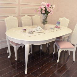French Style White Dining Table with 3 Leaves - A charming, delicate piece that can suit both a small, intimate group as well as fold out for a large group of 8.