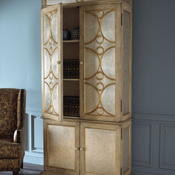 "Silver Armoire  - Perfect for any room in your home, this large armoire will provide extra storage for books, sweaters or even linens.  Four doors open to reveal three adjustable shelves. Hand painted with silver-leaf and golden accents. 43""W x 18""D x 86""T."