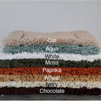 None - 100-percent Egyptian Cotton Plush No-slip 24 x 34 Bath Rug - Update your bathroom decor with this plush bath mat for a luxurious feel. Non-slip coating on the bottom of the rug prevents bunching or sliding. The cotton rug is machine washable for easy cleaning, and is available in eight color options.