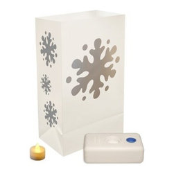 """LumaBase Battery Operated Snowflake Luminaria Kit - Set of 12 - The LumaBase Battery Operated Snowflake Luminaria Kit - 12 Count is a fun and beautiful way to illuminate your home with warmth and glow this winter. Includes 12 weather-resistant plastic bags 12 battery operated tea light candles (replaceable batteries included) 12 LumaBases (reusable flame-resistant candleholder that anchors the luminaria). About JH SpecialtiesFounded in 1989 JH Specialties originated when the company's entrepreneurs sought to redesign a bulky and messy celebration staple. Today JH Specialties offers unique decorative Luminarias and accessories for special and seasonal occasions to event planners neighborhoods fundraising organizations and retail stores. Since special occasions shouldn't be hard to plan JH Specialties offer top-of-the-line products for unique events at a competitive price and a great value. The title of """"""""Leader in Luminarias"""""""" comes from their commitment to quality and customer service."""