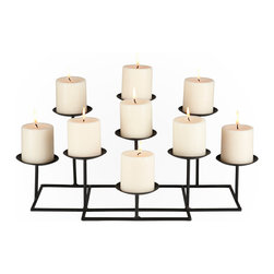 Holly & Martin - Campbell Candelabra - This glamorous metal candelabra is the perfect feature to adorn any shelf or mantel. With nine platforms to hold candles and a sturdy base, this metal candelabra will add warmth and a gentle glow to any room in your home. The candelabra is constructed of layers of rows with varying heights to give unique dimension to the piece.