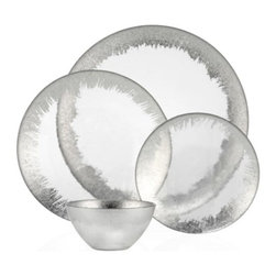 Z Gallerie - Solaris Dinnerware - Sets of 4 - Layer your table with rich metallic hues and decoratively distinct dinnerware with our stunning Solaris Collection. Crafted out of glass, a metallic hued perimeter detail stunningly embellishes the semi translucent glass dinnerware to creating an alluring three dimensionality. Due to the process used in creating the dinnerware, each piece will vary slightly in appearance. Easy to layer, the four piece collection embellishes your table setting with subtle sophistication and graphic interest. Available in both Gold and Silver. Exclusive to Z Gallerie. Sold separately in sets of four.