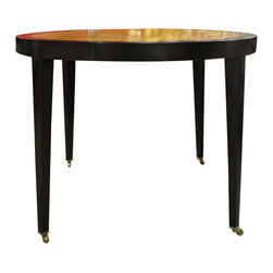 Donghia - Consigned Donghia Paris Card Table - Donghia's Paris table series showcases the beauty of wood. This card table features a dark lacquered maple frame with an English sycamore inset in a warm gold finish. A pencil drawer creates storage for small treasures. Brass casters beautifully contrast the wood and allow for easy positioning.