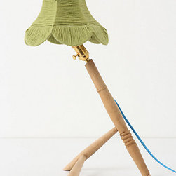 Anthropologie - Timber Legs Lamp, Green Tea - This table lamp made with wood table legs and topped with a parasol wool shade has a great mix of contemporary and vintage.