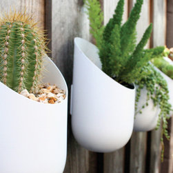 "Wallter Outdoor Planters - Houzz Contributor Lily Gahagan advises ""Help your favorite green thumb make the most of a small garden by gifting them a few of these planters. They attach onto a fence or wall for extra planting space, and look cute as can be to boot."""