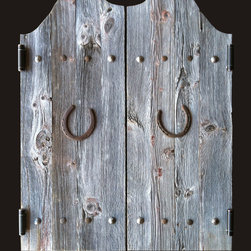 Custom Swinging Saloon Doors - Rustic swinging doors of reclaimed barn wood handcrafted to your specs. Hand forged iron nail head accents. Optional horseshoes for added Western appeal.
