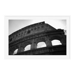 """Michal Venera Framed Print, Coliseum I, Mat, 28 x 42"""", White - On first glance, these iconic images of Rome are striking for their lush sepia tones, rich detail and intriguing camera angles. A closer look reveals the beauty of patterns, whether it is hundreds of stones that make up an old street, arches in the coliseum or the remaining three columns of a ruin. All exude a sense of order and timelessness amid the ever-changing landscape of city and country. 13"""" wide x 11"""" high 20"""" wide x 16"""" high 42"""" wide x 28"""" high Alder wood frame. Black or white painted finish; or espresso stained finish. Beveled white mat is archival quality and acid-free. Available with or without a mat.{{link path='shop/accessories-decor/pb-artist-gallery/artist-gallery-michal-venera/'}}Get to know Michal Venera.{{/link}}"""