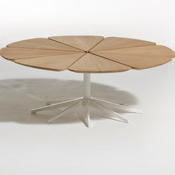 "Knoll - Richard Schultz Petal Coffee Table - Petal Coffee Table  designed by Richard Schultz  from Knoll  At A Glance:   Richard Schultz designed the Petal Table in 1960 as a companion piece to the Bertoia Chairs that were so enthusiastically received by the design-minded public. With a tabletop made from eight separate petals mounted on a cast aluminum ""spider"" bracket, the Petal Coffee Table distinctly resembles the Queen Anne's Lace flower that inspired Schultz.  What's To Like:   MoMA loved the Petal Tables when they came out - they grabbed them as soon as they were introduced.Each ""petal"" expands and contracts with the weather independently from the other petals, protecting the top from cracks.Yes, this coffee table can be used outdoors!The table has an exceptionally sturdy base due to its many legs.  What's Not to Like:   We really can't pick on anything besides price, since beauty is in the eye of the beholder. This is an expensive table,"