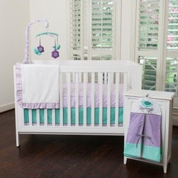 Pam Grace Lola Lavender 6 pc. Crib Bedding Set - Your nursery will be ready to go by the time your little one is here with the Pam Grace Lola Lavender 6 pc. Crib Bedding Set. This sweet set features a beautiful Harlequin design you're sure to love. Designed to fit a standard size crib, this set is made from a soft and comfortable poly/cotton blend and is machine washable for your convenience. This crib bedding set includes a blanket, crib skirt, two crib sheets, a mobile, and a diaper stacker. Additional Features Includes blanket, crib skirt, 2 crib sheets Also includes a mobile and diaper stacker About Pam Grace CreationsPam Grace Creations was created by Pam Val, a loving wife and mother of four, in January of 2006. Pam had seven years of experience in the baby bedding and nursery decor industry from working with her sister to run their own baby product business. She brought this experience and knowledge of the industry to her own company, and Pam Grace Creations was born.Pam is committed to providing new parents a combination of style, affordability, and convenience, and to that end she created her Nursery-to-Go 10-piece baby bedding sets. These sets include everything parents need to outfit their new baby's room in a range of styles and color palettes at an affordable price--without having to hunt down their nursery items piece by piece.