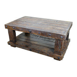 Old World Rustic Mesquite Coffee Table - This fantastic Old World Rustic Mesquite Coffee Table is constructed of solid Mesquite. No veneers are used, only solid planks of wood with a polyurethane type finish topped with a soft hand-rubbed wax. This finish makes this piece a perfect accent to any Spanish Colonial, Hacienda Style or Tuscan decor.  Notice the hand carved, hand forged iron accents. Beautiful!