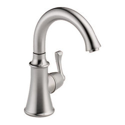 """Delta - Delta 1914-AR-DST Arctic Stainless Beverage Faucets Beverage Faucet - Product Features:    Made in the U.S.A. (Manufacturing plants: Greensburg, Indiana; Jackson, Tennessee)Fully covered under Delta s limited lifetime warranty  All-brass faucet body and handle construction  Timeless design for today s homes  Simple, elegant lines compliment traditional decor  Superior finishing process - faucet finish covered under lifetime warranty  High-arch gooseneck spout allows for unobstructed sink access    Product Technologies:    Diamond Seal: Delta DIAMOND Seal Technology utilizes a ceramic disc valve with a real diamond coating to produce a faucet that will last up to 5 million uses. That s an amazing 10 times the industry standard, guaranteeing a lifetime of leak-free, trouble-free performance.  Eco Friendly: Through a number of technologies and innovations, Delta's Eco Friendly faucets achieve the impossible: A faucet that feels like more water, while actually conserving water. There are many advantages to this beyond helping protect our nation's water resources. First, Delta's Eco Friendly faucets splash less; you won't have to wipe your counters as much. Second, they use less hot water, preserving your hot water supply and reducing associated water-heating costs. Third, you will feel a little less guilty leaving the water running for longer periods.    Product Specifications:    Overall Height: 9-1/4"""" (measured from counter top to highest point of faucet)  Spout Height: 6-7/8"""" (measured from counter top to faucet outlet)  Spout Reach: 5"""" (measured from center of faucet base to center of faucet outlet)  Number of installation holes required: 1  1.5 gallons-per-minute flow rate  Installs onto decks up to 4"""" thick  1 handle included  ADA complia"""