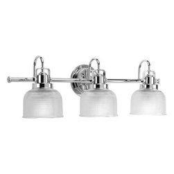 "Progress Lighting - Progress Lighting P2992-15 Archie 3 Light Bathroom Lighting in Polished Chrome P - Archie is a standout in any room and provides a fun and fashionable way to light your home. The authentic, prismatic style glass shade diffuses light to provide functional and stylish illumination. This fixture can be installed with the glass facing up or down to suit your preference.Clear double prismatic glass shade Finely crafted strap and knob details Steel construction Back plate covers a standard 4"" hexagonal recessed outlet box Mounting strap for outlet box included Medium base ceramic socket(s) Pre-wired UL-CUL Damp location listedBulb Base: Medium Bulb Type: Incandescent Collection: Archie Extension: 7 Finish: Polished Chrome Height: 8-3 4 Max. Wattage: 100 Number of Lights: 3 Style: Traditional Classic UL Listed: Yes UL Rating: Damp Location Weight: 10 Width: 26-1 4"