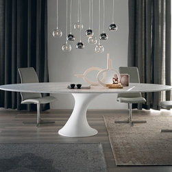 Cattelan Italia - Cattelan Italia | Reef Dining Table - Made in Italy by Cattelan Italia. Inspired by the voluptuous curves of a surfboard and the graceful posture of the surfer, the Reef Table is a unique contemporary piece that will bring a wave of elegance to any modern dining space. Its elegant beauty is so infectiously universal that it will make a bold fashion statement even in office environments. The table top comes in  MDF with your choice of shape and size. Adding to the chic factor is the table's striking trumpet-style Cristalplant base in a beautiful slanted position.  Cristalplant is a rock-hard natural-based, non-toxic, hypoallergenic and fire-proof material that's made in Italy through advanced technologies and is used for making decorative items and furniture.