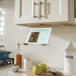 Schrock Tablet Holder - Our under-cabinet tablet holder keeps tech devices away from messy ingredients and spills and allows charging in all positions. The simple design also allows tablets to be concealed under the cabinet when not in use.