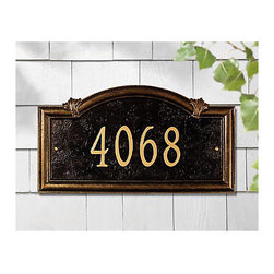 Ballard Designs - Somerset Arch One Line Wall Address Sign - Made in the USA. Choose One Line or Two Line design. Available in wall mount or in-ground installation style. Make your address the nicest one on the block. It's crafted of cast aluminum with weather-resistant paint to last the life of your home. Antique gold lettering with black background. For One Line: Up to 5 numbers/spaces; for Two Line: Up to 5 numbers/spaces for top line and up to 16 characters/spaces for bottom line.Somerset Arch Address Sign features:. . . *Please note that personalized items are non-returnable.