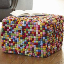 Puffball Pouf - This felted wool pouf is so clever. It's soft yet cubed, and it's colorful, it can go in a minimal modern room or light up a cluttered kid's playroom.