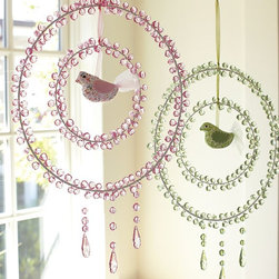 Crystal Dream Catchers - These delicate crystal dream catchers will have your little one entranced from the minute you lay them in their crib. Filtering light through each delicate crystal, these hanging wonders add subtle detail to a room. Place them near a window as shown for their best effect.