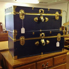 Inventory - Blue and gold storage trunks.