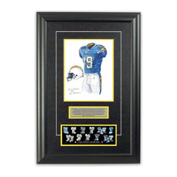"""Heritage Sports Art - Original art of the NFL 2007 San Diego Chargers uniform - This beautifully framed piece features an original piece of watercolor artwork glass-framed in an attractive two inch wide black resin frame with a double mat. The outer dimensions of the framed piece are approximately 17"""" wide x 24.5"""" high, although the exact size will vary according to the size of the original piece of art. At the core of the framed piece is the actual piece of original artwork as painted by the artist on textured 100% rag, water-marked watercolor paper. In many cases the original artwork has handwritten notes in pencil from the artist. Simply put, this is beautiful, one-of-a-kind artwork. The outer mat is a rich textured black acid-free mat with a decorative inset white v-groove, while the inner mat is a complimentary colored acid-free mat reflecting one of the team's primary colors. The image of this framed piece shows the mat color that we use (Yellow). Beneath the artwork is a silver plate with black text describing the original artwork. The text for this piece will read: This original, one-of-a-kind watercolor painting of the 2007 San Diego Chargers uniform is the original artwork that was used in the creation of this San Diego Chargers uniform evolution print and tens of thousands of other San Diego Chargers products that have been sold across North America. This original piece of art was painted by artist Nola McConnan for Maple Leaf Productions Ltd. Beneath the silver plate is a 3"""" x 9"""" reproduction of a well known, best-selling print that celebrates the history of the team. The print beautifully illustrates the chronological evolution of the team's uniform and shows you how the original art was used in the creation of this print. If you look closely, you will see that the print features the actual artwork being offered for sale. The piece is framed with an extremely high quality framing glass. We have used this glass style for many years with excellent results"""