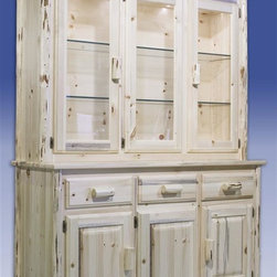 Montana Woodworks - Montana China Hutch w Sideboard (Ready To Fin - Finish: Ready To FinishThe bottom part has two cabinets. Three smaller drawers. Hutch has three large, glass fronted doors. Adjustable glass shelves. Three display lights. Handcrafted. Lodge-pole pine log accents. 20 years limited warranty. Made from solid American grown pine. Hand-crafted in the US, each Montana Woodwork product is made from unprocessed, solid wood that highlights the character of its source tree with unique knots and grains. Made in USA. No assembly required. 55 in. W x 21 in. D x 80 in. HThe china hutch with sideboard by Montana Woodworks is truly a work of exquisite craftsmanship and meticulous forethought. The china hutch is perfect for displaying your finest heirloom china. The sideboard has plenty of space for holding all the daily necessities of a modern, if rustic, household. Comes in two section; assemble by placing Hutch on Sideboard and place shelving where desired prior to use.