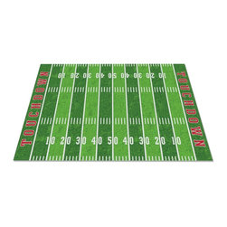Football Field Rug - This is available as either an area rug or wall-to-wall carpeting, so you can turn the entire floor into a field. Score!